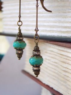 Gorgeous Long Dangle #Earrings inspired by the Victorian Era. These Czech Glass beads are in Teal blue with compliments of…