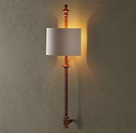 Lorraine Architectural Railing Sconce - RH's Lorraine Architectural Railing Sconce:We quarried architectural treasures from vintage railings, recreating and repurposing them as distinctive metal accent lighting. Crafted from cast iron and steel, they have a weathered, distressed patina that mimics that of the original found objects.