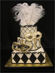I love this cake with the fabulous black and gold juxtaposing patterns. It looks so regal and glamorous it would certainly fit in with any masked themed decor.