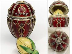 The Rosebud Egg - 1895. Made for Nicholas II of Russia, who presented the egg to his wife, Empress Alexandra Fyodorovna. It was the first egg that Nicholas presented to Alexandra. The egg opens like a bonbonnière to reveal a yellow-enamelled rosebud, in which the two surprises were originally contained. The surprises are missing, but they were a golden crown, with diamonds and rubies, and cabochon ruby pendant.