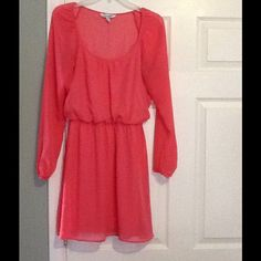 Peach Long Sleeve Dress Peach Long Sleeve Dress with elastic in waist and sleeves. Comes above knees. See through sleeves Speechless Dresses Mini