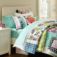 @Cheryl Harner I know we said only duvet covers, but this is so colorful & cheery - and look at all it with the sheets & shams!