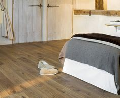 Liven up your home with the Quickstep White Oak Medium which comes in a rustic wood grain finish Bedroom Flooring, Vinyl Flooring, Laminate Flooring, Quick Step Flooring, White Oak, Rustic Wood, Bed Pillows, Pillow Cases, Bedroom Decor