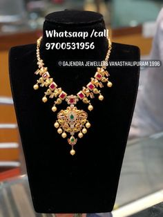 Nakshi pachi peacock pearls ruby emeralds handmade . Beautiful gold necklace with pearl hangings. 14 November 2018