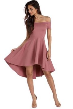 """<p>Off the shoulder dresses are all the rage this season! Show off your amazing fashion sense with this dress that features an elastic off the shoulder neckline,short sleeves, a slim fitting bodice and a super cute skater skirt with a hi low hem.</p>  <p><em>Model is 5'6 with a 32"""" bust, 23"""" waist and 34"""" hips. She is wearing a size small.</em></p>  <p></p>"""