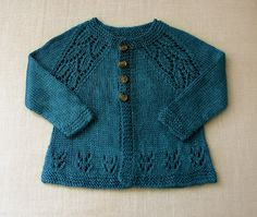 Knit baby cardigan sweater with leaf motif