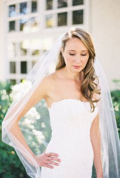 Brides.com: Wedding Hairstyles that Work Well with Veils. A Wedding Hairstyle with Soft Waves. This bride pulled back her shiny soft waves with an extreme side part. Adding a classic tulle veil keeps the look sweet and simple.   Browse more long wedding hairstyles.