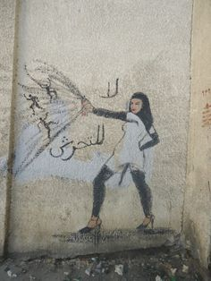 """""""No to harassment"""" by Mirah Shihadeh. The woman is depicted blowing away street harassers with her can of spray paint.  Read more: Feminist Street Art of Cairo 