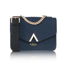 Ida Cross-Body Bag in Blue by Labante London - This beautiful, quilted cross-body bag has a wide contrast strap is the perfect bag for your everyday needs. Featuring a quilting design with a lovely gold chain which can also be used as a top handle helps transform the bag from a cross body to a handheld clutch. It includes a cash pocket and a detachable long strap. 22cm W, 8.7cm D, 16cm H. Ethically and sustainably made. Vegan.