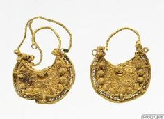 A pair of circular shaped ear-rings in open filigree work, with arched incision…