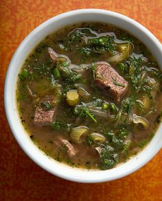 Venison Stew with Greens - venison stew meat, olive oil, Salt, green onions, green garlic or garlic cloves, fennel, tomato paste, chicken broth, water, ouzo or other anise-flavored liqueur, oregano, lemon, parsley, spinach, lamb's quarters, etc, Black pepper