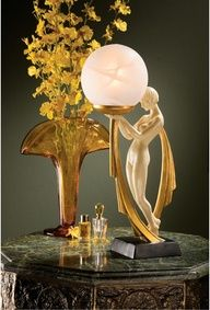 Design Toscano The Desiree Art Deco Lighted Sculpture Table Lamp A soft glow spreads through the frosted glass globe to highlight the gracefully