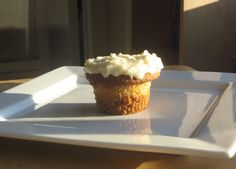 cupcakes with graham cracker crust and coconut cream icing