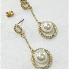 Faux Ivory Pearl Rhinestone Drop Dangle Earrings Stunning! Wedding worthy. Brides, Bridesmaids. These are all done in gold tone metal with rhinestones and a large Faux Pearl. Post and back closures. Gift Box included. Jewelry Earrings