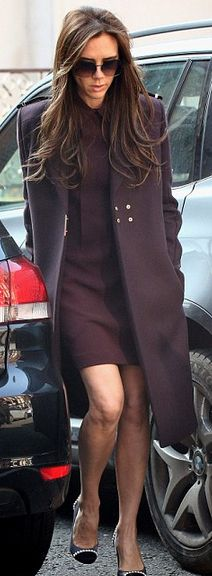 Victoria Beckham in a dress, sunglasses, and coat by Victoria Beckham Collection