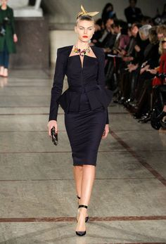 In theZac Posen Runway 2012 Fall collection it is easy to see how contemporary fashion takes inspiration from the past. The design depicted here takes inspiration from the 1950's. The nipped in waist, peplum, and fitted skirt were popular in the 1950's. 4/5/15