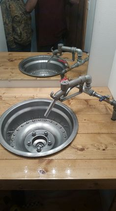 My mechanic/drag racing husband built this wheel sink for the bathroom. My mechanic/drag racing husband built this wheel sink for the bathroom. Car Part Furniture, Automotive Furniture, Automotive Decor, Furniture Plans, Kids Furniture, Furniture Design, Handmade Furniture, Modern Furniture, Man Cave Furniture