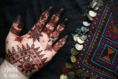 """Mauritanian henna design next to embroidery and coins on traditional Moroccan galabeya.    Get Heather's book """"Mauritania"""" here:  http://artisticadornment.com/henna_tattoo_supplies/henna-design-e-books/mauritania-mauritanian-henna-designs-by-heather-caunt-nulton"""