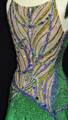 A back panel that's sure to garner attention Latin Ballroom Dresses, Ballroom Costumes, Burlesque Costumes, Ballroom Dance Dresses, Belly Dance Costumes, Peacock Dress, Rhinestone Dress, Beautiful Costumes, Dance Fashion