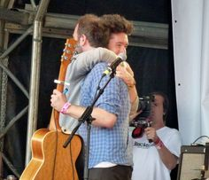 Best friends Dan (bastille) and Ralph (to kill a king) hugging. Ahhh, they are coming here in April together!! *cries*