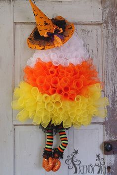 Candy Corn Wreath Tutorial - Video and written instructions, supply list.  RAZ Witch Hats and Legs Combo  http://www.trendytree.com/blog/candy-corn-wreath-tutorial/