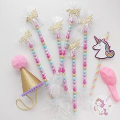 Magical celebrations call for magical party favors. This may be my new favorite color combo...simply dreamy! (Unicorn candy wands with iridescent tinsel: $1.65 each. Colors can be customized. Order via email in profile.) Party hat by @poshahoolie . Unicorn straws from Target. #handcraftedparties #unicorns #unicornparty #partyhat #candywands #sixlets #unicornpartyfavor