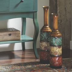 Set of 2 Metal Vases  from Midnight Velvet.  Embossed metal vases have painted finish