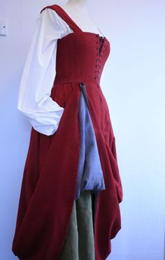 Note: supportive kirtle in wool with blue lining and green underskirt. Laced or pinned on sleeves would be appropriate. Tudor  – Time Tailor
