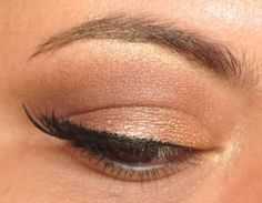 A sleekly shimmering tan eye from Khroma Beauty Khloe's Kardazzle Face Palette