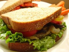 Aspiring Homemaker : Homegrown Tomato Sandwiches Lettuce, Tomato, sweet Onions w/ garlic, smoky mushrooms, banana peppers, homemade mustard Carrot Sticks