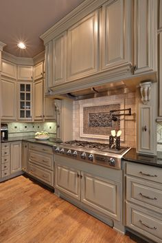 I like the style of this kitchen and how the cabinets go to the ceiling