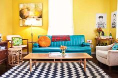 Love the living room over at A Beautiful Mess.... especially that turq sofa, yellow walls, patterned rug...