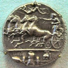 Syracusan coin, showing a chariot with maritime symbols, commemorating the naval victory. ca. 400 BCE–ca. 370 BCE. Berlin, Bode-Museum
