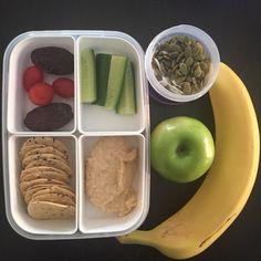 Simple school lunch. Hommus. Cucumber. Rice crackers. Tomato. Dates. Apple. Banana. Coconut chips. Pepitas. Almonds (for high school only)  #cutoutthecrap #glutenfree #dairyfree #preservativefree #additivefree #school #lunchbox #lunch #morningtea #kidsfood #noexcuses #hommus #coeliac #collettewhite #food