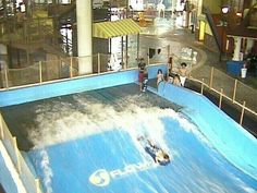 It's called a Flowrider .It's like a machine that u practice surfing on