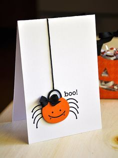 "Spooky but ""oh so cute"" spider bucket dangles from an embroidery floss web."