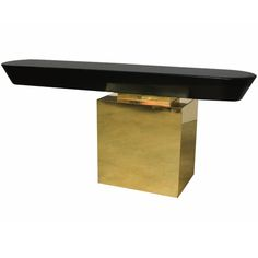 A Cantilevered Console in Brass and Lacquer