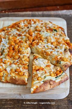 This Vegan Buffalo Chickpea Pizza with White Garlic Sauce and Celery