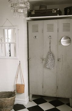 we bought lockers like these at a yard sale for our breezeway/mudroom.... I like the idea of adding th shelf above them and the mirror on the outside will go on Miss Kaetlyn's for sure :)