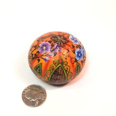 Pumpkin house, one of the prettiest yet, with beautiful blue and purple detailed flowers. This rock is of a sandy composition, so it will not stand up to the elements of outdoors as well as some of my other rocks. 2 x 2 1/2 x 2