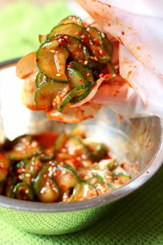 Cucumber kimchi is a super simple condiment that adds all of the spice and tang of kimchi but only takes about 20 minutes to make - no fermenting necessary!  www.kimchichick.com