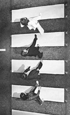 The Beatles crossing Abbey Road, 1969.