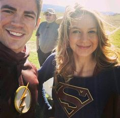 Grant Gustin as Barry Allen/The Flash and Melissa Benoist as Kara Danvers/Supergirl on the set of Supergirl