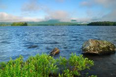 There are a few reasons you probably haven't heard of Lake Umbagog. First, it's tucked away in a remote corner of New Hampshire and Maine, about hours north of Concord. Plus, Lake Umbagog State Park is one of the youngest state parks, operating only since North Conway New Hampshire, Hampton Beach Nh, Places To Travel, Places To See, New England Usa, State Parks, Beautiful Places, Scenery, Vacation
