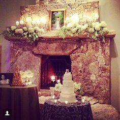 Gorgeous candlelit and floral display on Ian's Chapel mantle - Whim Florals | Camp Lucy
