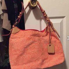 Dooney and Burke bag Dooney and Burke orange / white pocket book/ brand new Dooney & Bourke Bags Shoulder Bags
