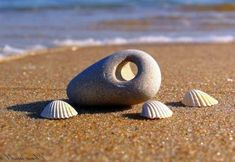 Holey Stones are intriguing naturally occurring stones and pebbles with a hole… Native American Tools, Hag Stones, Glass Rocks, Driftwood Beach, Sea Witch, Sticks And Stones, Stone Crafts, Beach Stones, Kitchen Witch
