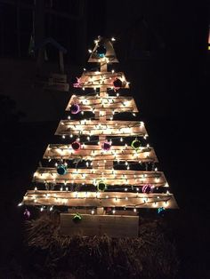 large pallet Christmas tree with lights and colorful ornaments