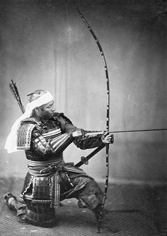 Samurai holding a yumi. The Yumi (Japanese Bow) is an asymmetrical longbow over two metres in height that is traditionally made of bamboo, wood and leather, while the Ya (arrows) of this period have bamboo shafts with eagle or hawk feather fletchings. Practiced for centuries as both a Gendai budo (Martial Art) and a form of Zen meditation, the sport of Kyudo is still widely studied throughout Japan.