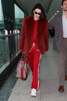 February 18, 2017 Zeynep Arçay fur jacket, a sweatshirt, embroidered track pants, Fila sneakers and a Gucci bag